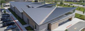 Angled metal roof panels create a vision of wings for Illinois rehab facility