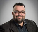 Tom Schultz promoted to associate at TAT