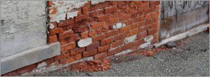 Moisture in mass masonry walls (Failures)