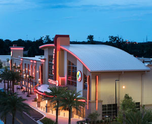 Curved metal roof welcomes moviegoers at Florida theater
