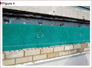 Masonry veneer installation, with waterproofing membrane and drainage layer behind the masonry veneer.