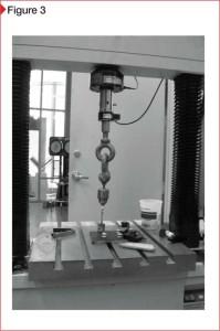 Pull-adhesion testing using a universal test machine.