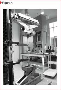 Elongation testing using a universal test machine.