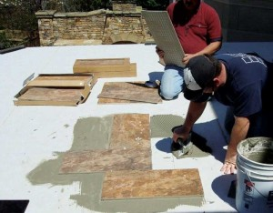 Installing tile over a waterproofing membrane, using thin-set mortar. Photo courtesy Duradek