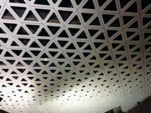 A closer look at the matted aperture with veneer curtain wall on the Cineteca Nacional's folded skylight over ramps.