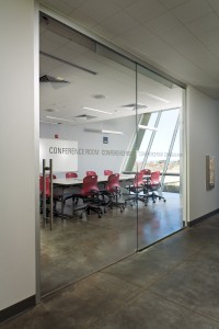 The San Diego National Wildlife Refuge Visitor and Administrative Complex employed ceiling-mounted glass-panel doors throughout its design to provide a connection between the outside saltwater marsh landscape and its interior.