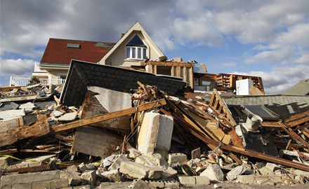 A destroyed beach house in the aftermath of 2012's Hurricane Sandy in Far Rockaway, New York. The devastation of such storms can be mitigated through stringent building codes, but not all Gulf or Atlantic Coast states are equal in this regard. Photo © BigStockPhoto/Leonard Zhukovsky