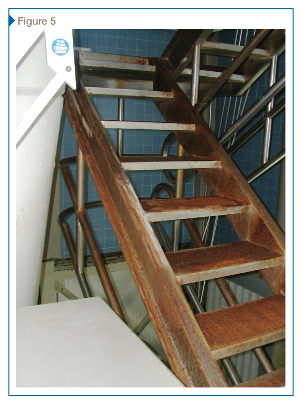 This poorly painted steel diving platform stair experienced heavy corrosion due to direct wetting.