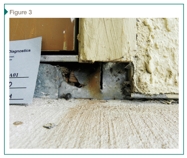 In the survey, wood rot below balcony doors was common. At this example, defects include physical damage to the metal flashing (tearing and saw-cut) and an unsealed lap seam.