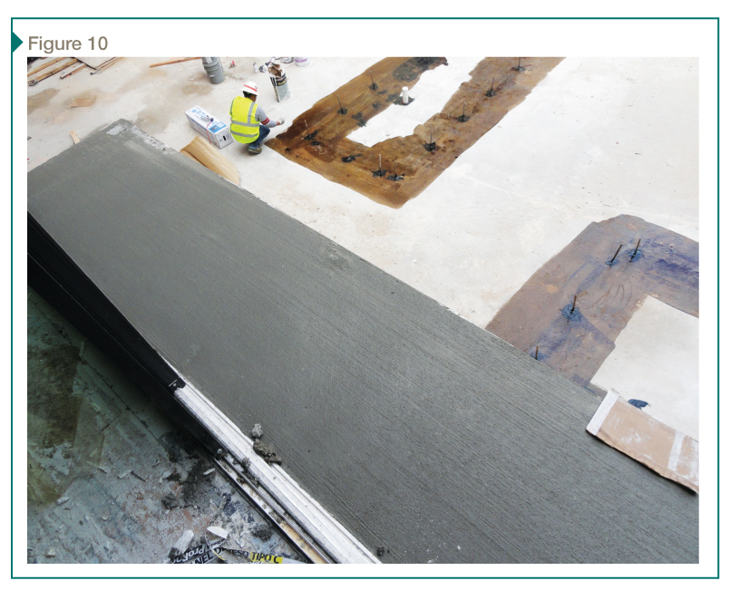 The concrete topping slab is placed with careful screeding to ensure uniform slope. Control joints will be scribed into the fresh concrete to limit cracks in the field of the deck.