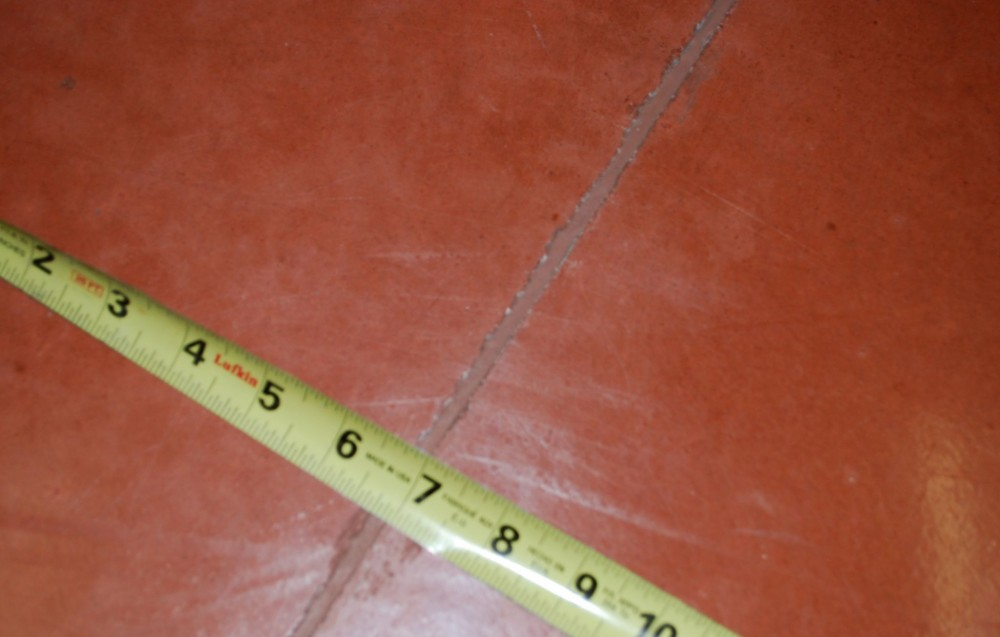 Many people worry steel fibers will show at the floor surface, making the floor look worse. This floor, made with colored concrete and Type II fibers, 25 mm (1 in.) long, shows the steel fibers need not affect appearance.