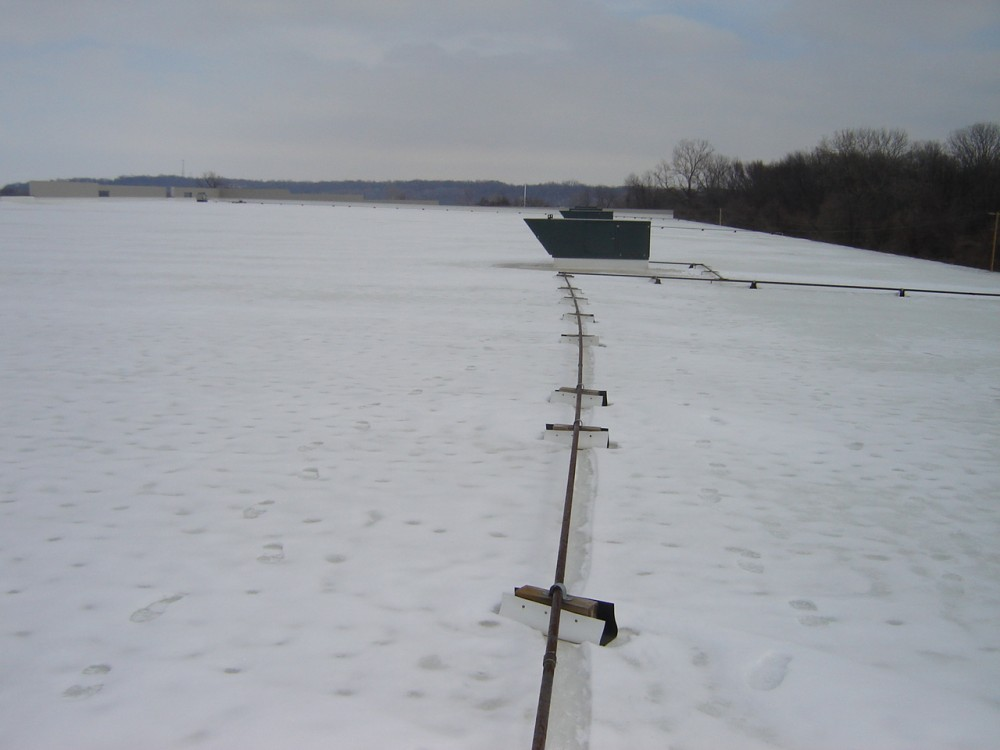 Gas lines supplying HVAC rooftop equipment can be affected by snow accumulation.
