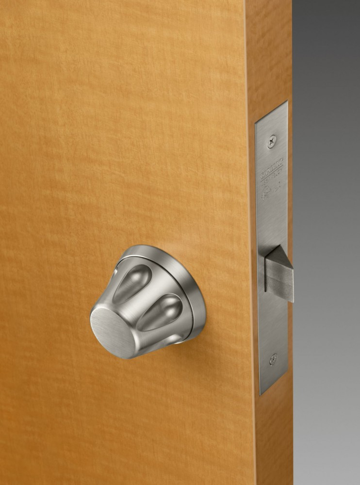 Detention knobs are used with mortise locks and feature a sloped surface throughout it.