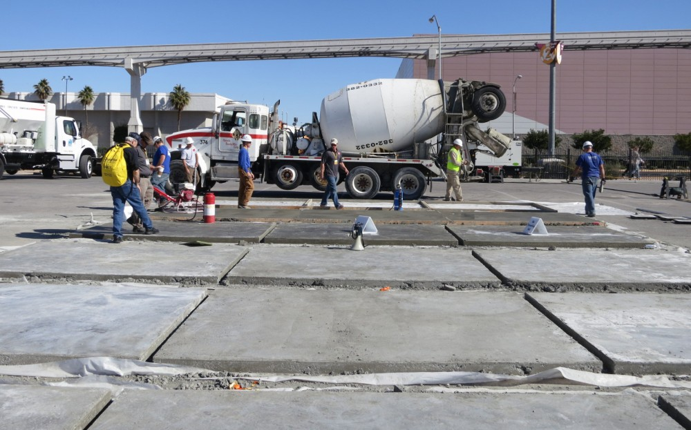 Slabs were placed three times a day at World of Concrete 2013, divided into a trio of sections: one finished with added water, one with no troweling aid, and one with a colloidal silica-based finishing aid. They were finished by volunteers (i.e. professional finishers visiting the show). Workability time was measured, and surface compressive strength of the slabs was subsequently tested.