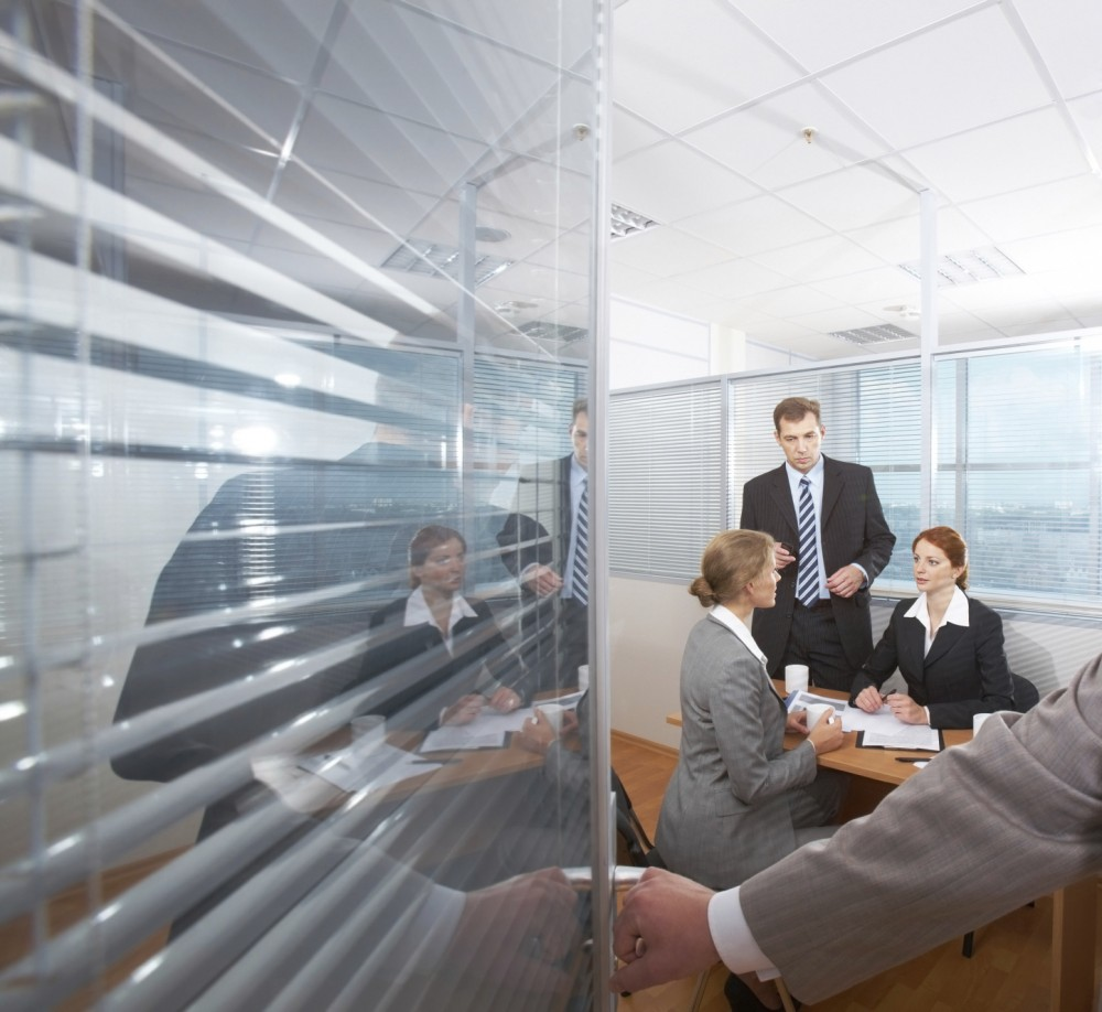 Sound masking continues to provide acoustic control when a meeting room's door is open and the isolation it provided virtually disappears. [CREDIT] Photo © iStockphoto/mediaphotos