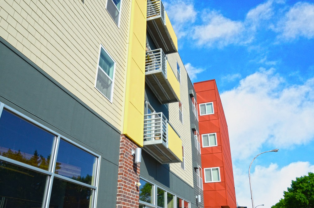 This apartment complex in Grand Forks, North Dakota, employs fiber cement plank, panel, shingle, and trim.
