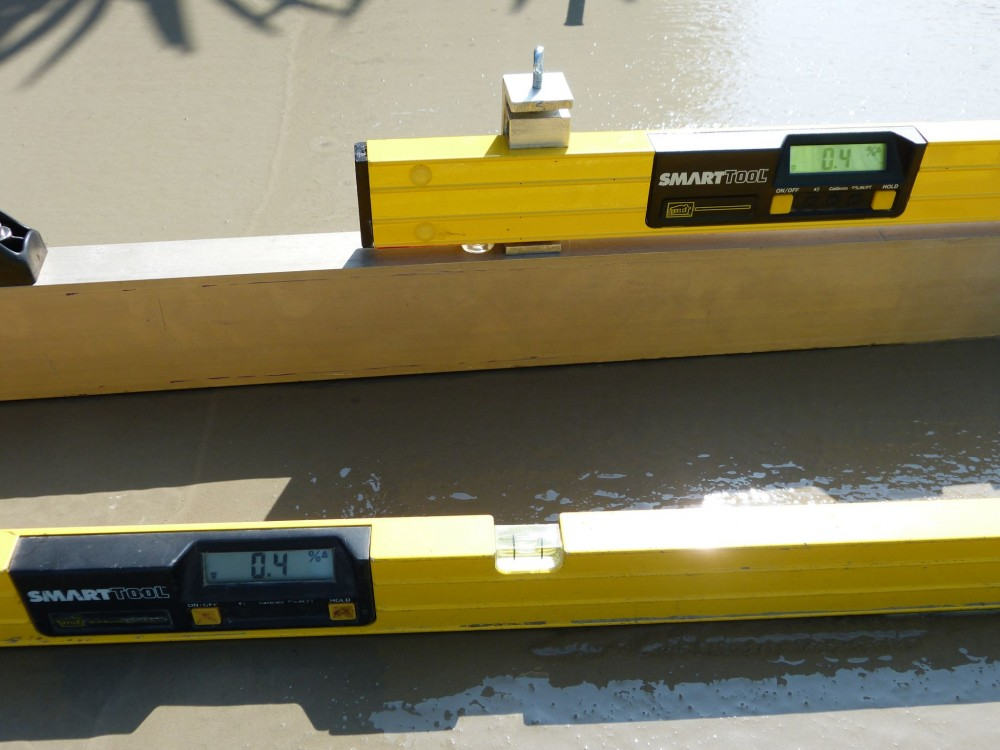 Demonstrating the reliability between a level directly on the concrete and mounted on the mag beam (a), a walking 300-mm (12-in.) profiler on articulating feet (b), and a walking profiler used on a mag screed to check the first cut.