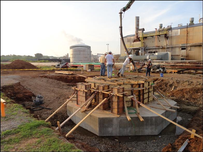 Placement of a pedestal base for a nitric acid absorber using activated fly-ash cement concrete in Tuscumbia, Alabama, to alleviate corrosion damage.