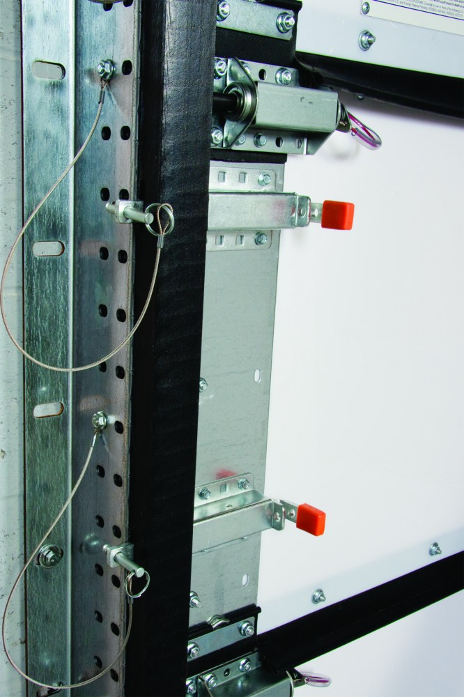 This photo provides details of the slide locks and pins that offer enhanced security during high-wind events.