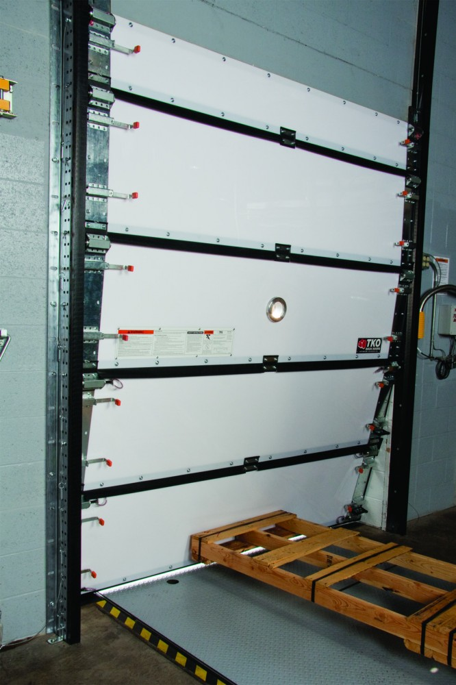 Impactable doors with wind load still protect against forklift impacts.