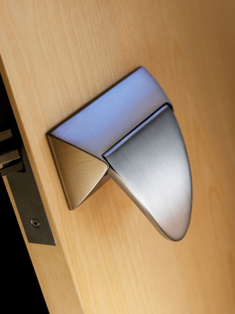 The paddle shape of push/pull trim creates a target for door activation.