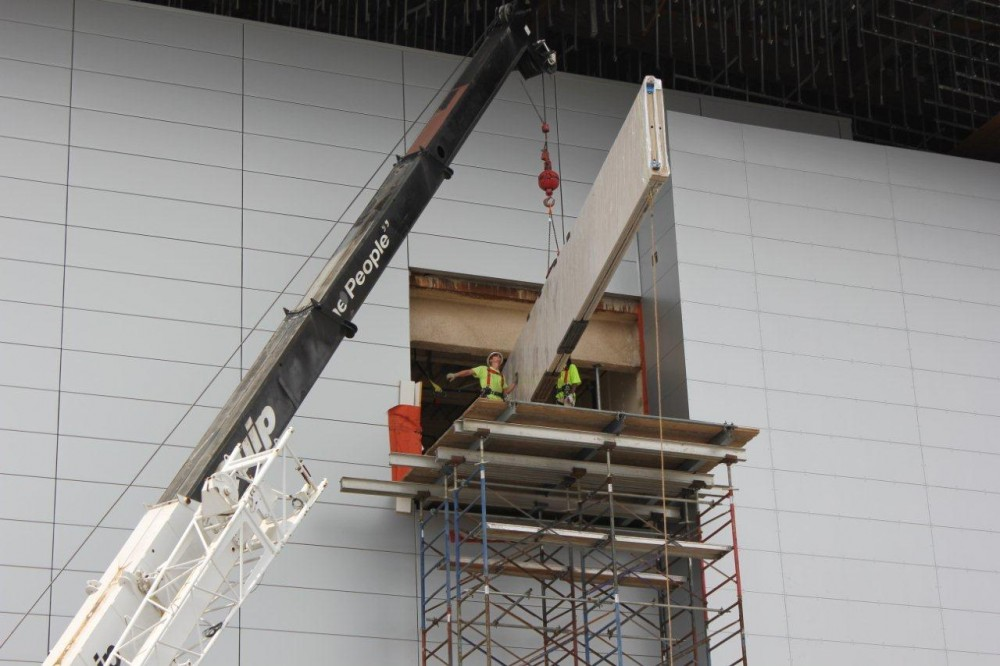 This crane and scaffolding were part of an unusual installation process as workers had to get the 12.7-m (41 ½-ft) operable partition panels inside the Grand Ballroom on the top floor. Photo courtesy Crawford Door Sales of Nashville Inc.