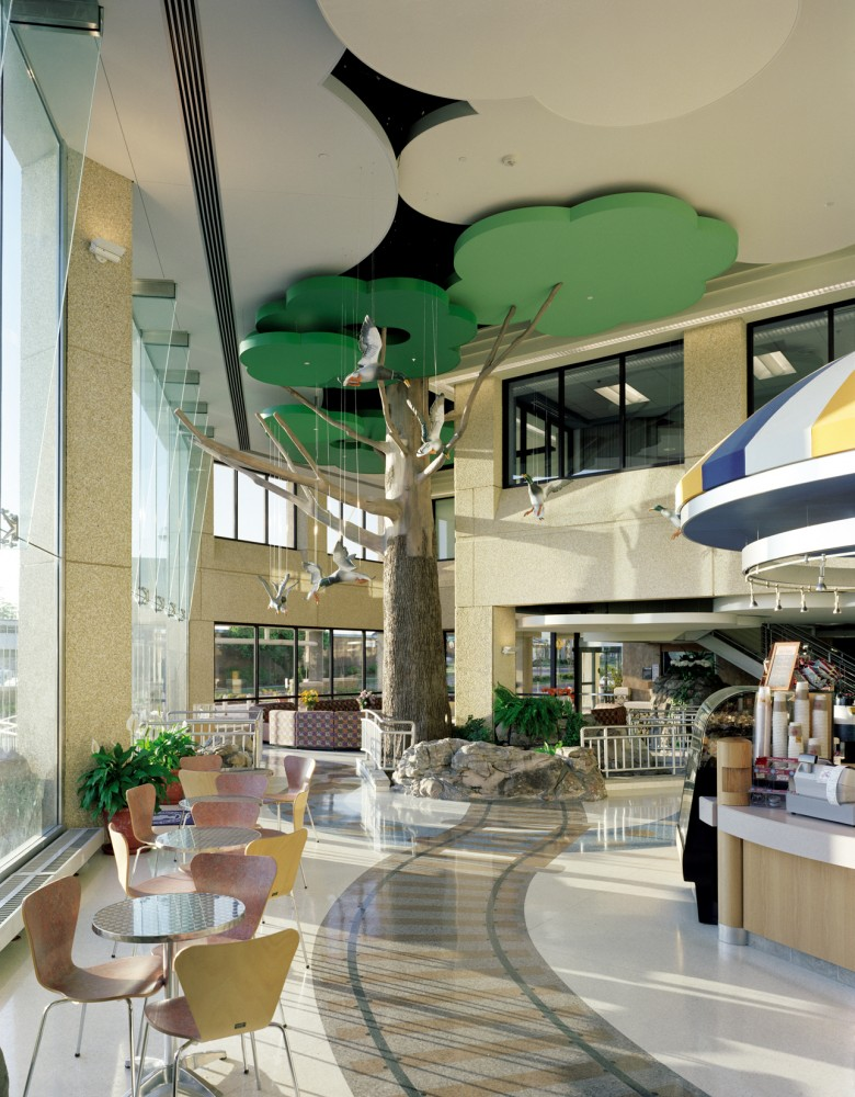 "Arkansas Children's Hospital 23,969-m2 (258,000-sf) South Wing was designed by Cromwell Architects with the theme, ""Healing is in our Nature."" The facility maintains a strong connection to the environment through both outside views and interior details. The ceiling systems were custom-shaped to resemble clouds and tree canopies."