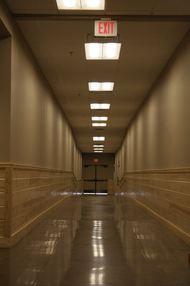 A polished concrete hallway for Sky Ranch in Van, Texas, was completed with finish falling within the ranges specified for the Level 3 finished gloss. [CREDIT] Photo courtesy USA Floor Tec Inc.