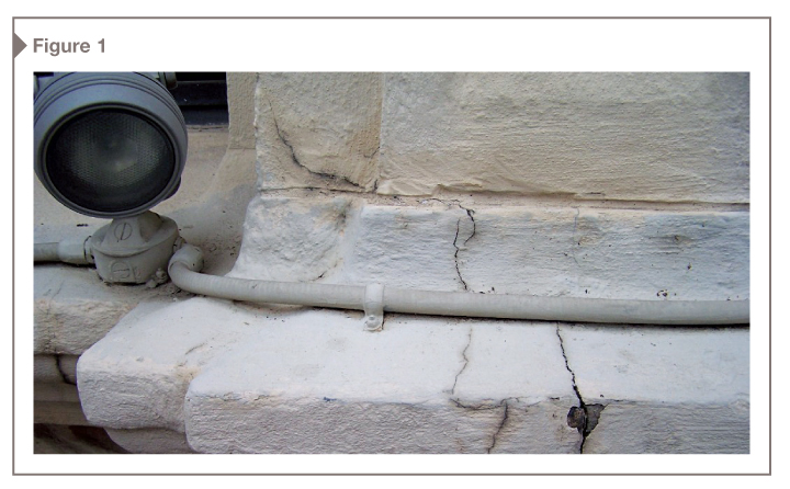 On this historic building, cracks propagated through the previous failed elastomeric coating. The restored building with a new, robust elastomeric wall coating is shown above.