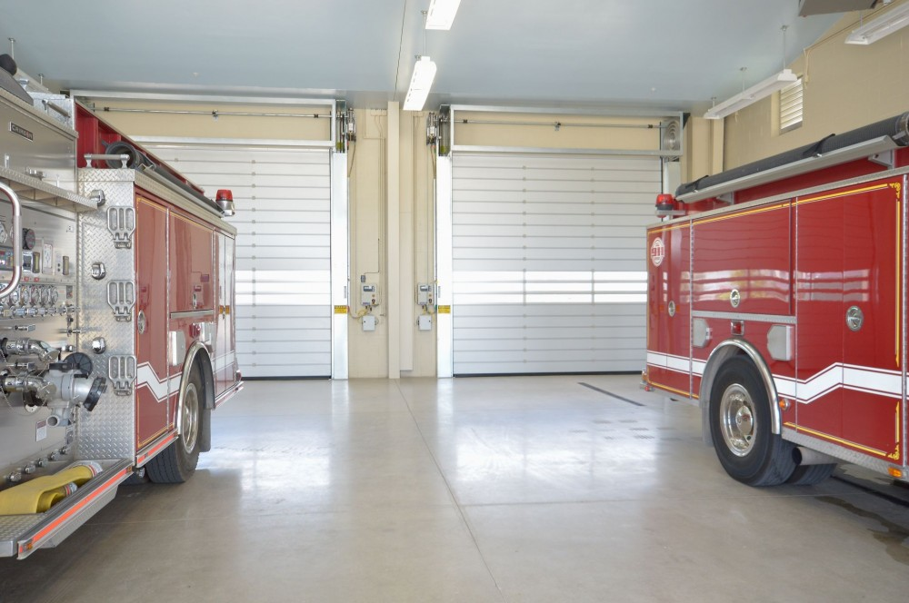High-performance security doors (HPSD) open fast and allow for quick exit of emergency vehicles from fire stations.