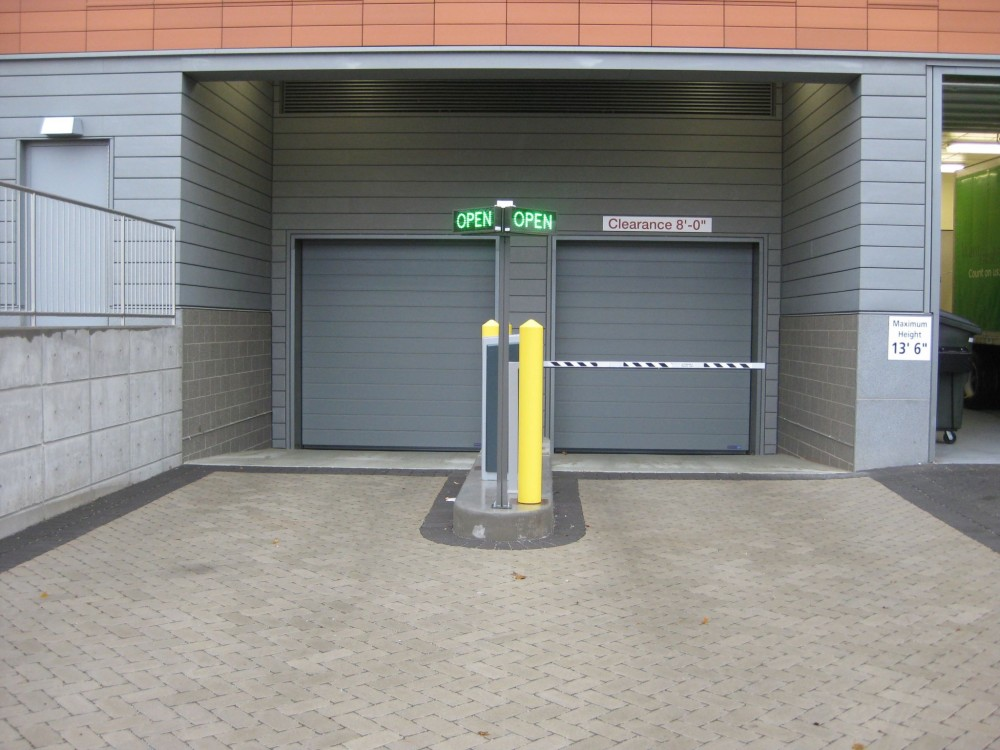 Some parking areas have limited vehicle access openings, so operational dependability of the door is critical.