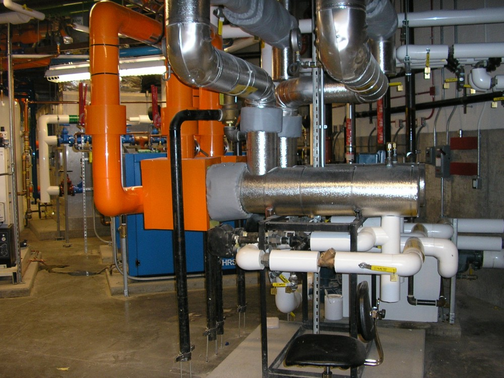 These large mechanical rooms have complicated piping. The specifications called for color-coded piping which has made the facility's operation easier for the operators.