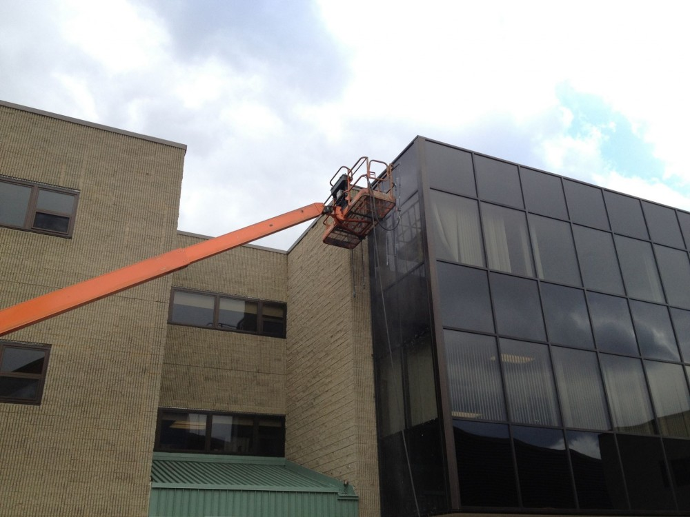 This photo shows AAMA 503 field testing of an upper floor with the spray-rack supported by a telescoping boom. The air chamber under negative pressure is interior to the building. Photos courtesy AAMA