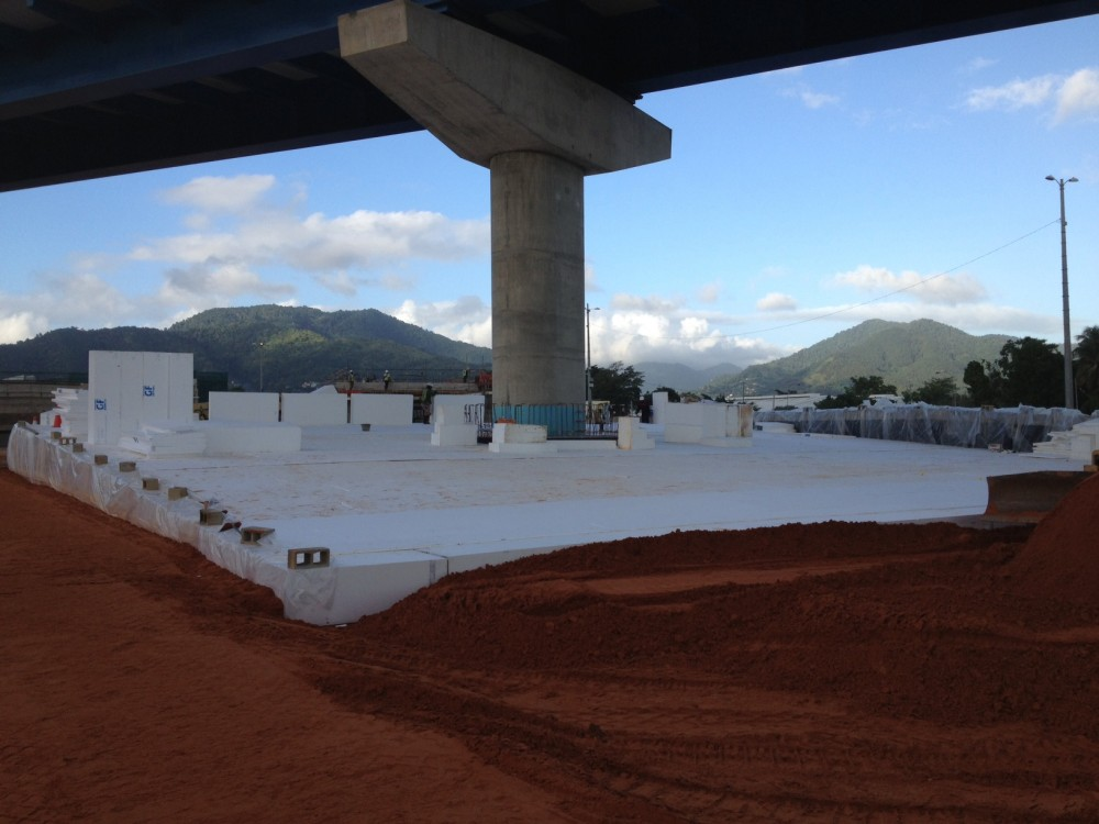 Engineers specified expanded polystyrene (EPS) geofoam as a lightweight embankment fill to reduce loads on an existing support pier's pile cap in a Trinidad highway interchange. [CREDIT] Photo courtesy Vinci Construction Grands Projets