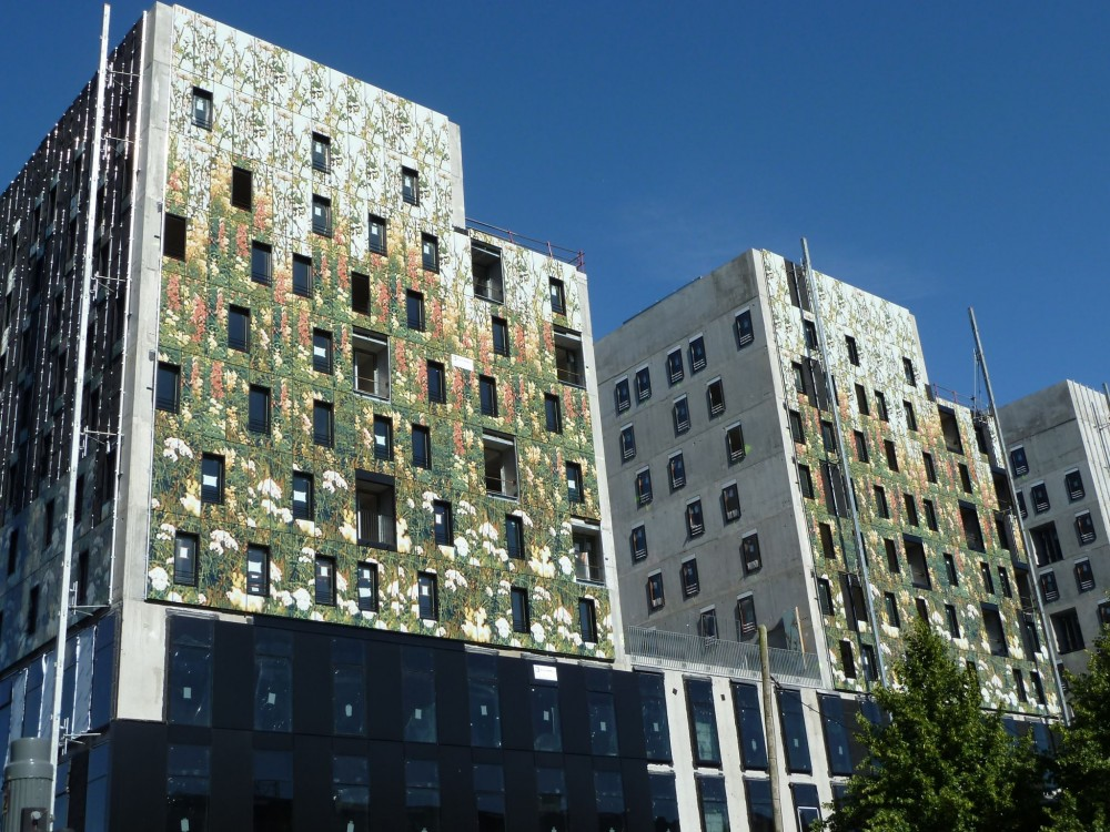 Otherwise-plain façades can be upgraded with relatively lightweight and cost-effective digital printing. [CREDIT] Photo courtesy Dip-Tech Digital Printing Technologies Ltd.