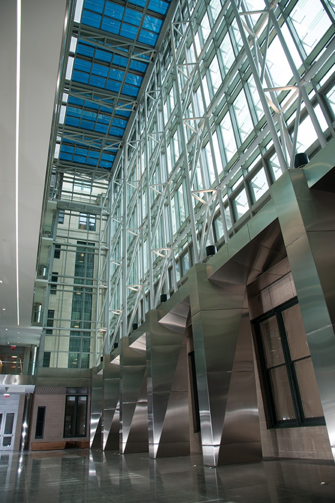 The renovation of the General Services Administration (GSA) headquarters included a seven-story atrium built atop a formerly open-air courtyard. Electronically tintable dynamic glass was chosen for the atrium's skylight to provide a comfortable environment for occupants, reduce energy usage, and demonstrate how green technologies are being incorporated into renovated buildings. [CREDIT] Photo courtesy Sage Electrochromics. Photo ©Montana Pritchard Photography