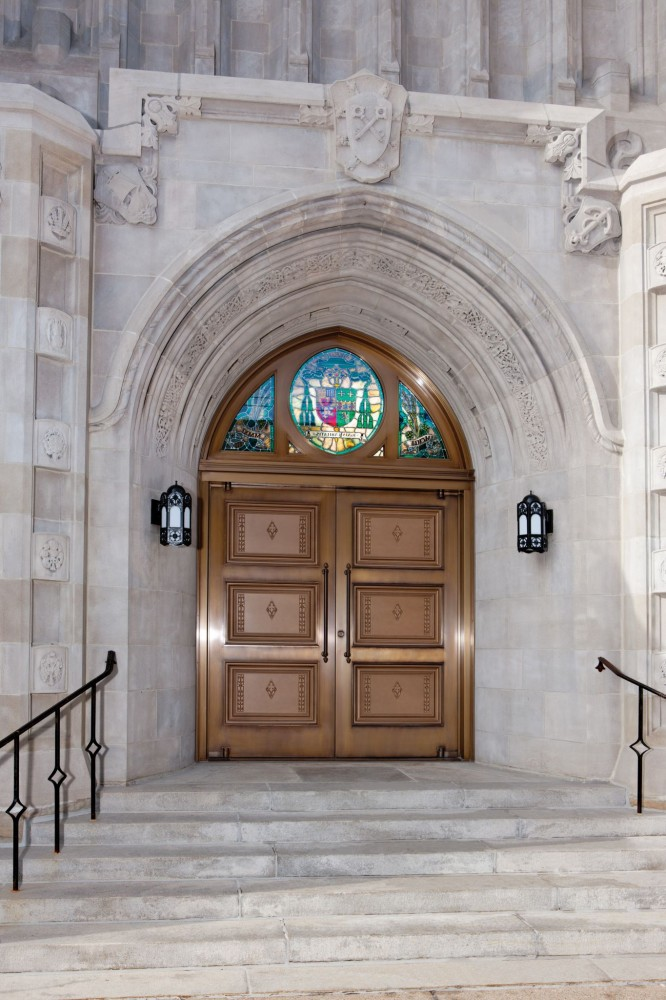 A pair of balanced doors offers a pleasing aesthetic to match the exterior of the decades-old Blessed Sacrament Cathedral in Greensburg, Pennsylvania. Both doors contain a total of six bronze panels—three on the front and three on the back—and weigh 317.5 kg (700 lbs), making the balanced design necessary to facilitate easy opening and closing. [CREDIT] Photo courtesy Ellison Bronze
