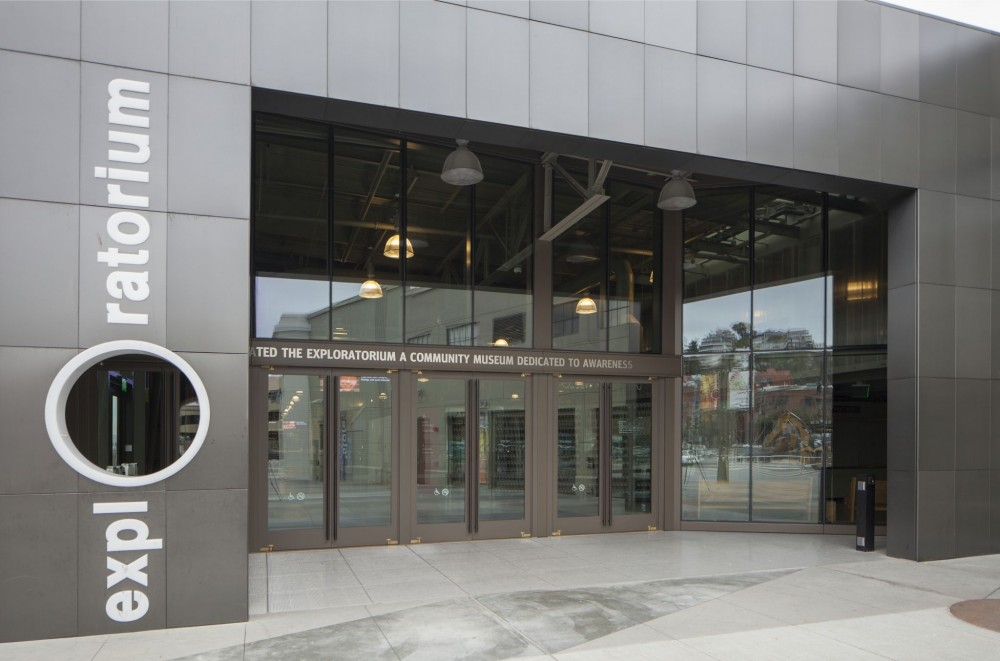 The custom balanced doors at the museum entrance of the Exploratorium in San Francisco feature stile and rail-type construction of painted extruded aluminum material. Photos © Heather Collins Roe Photography