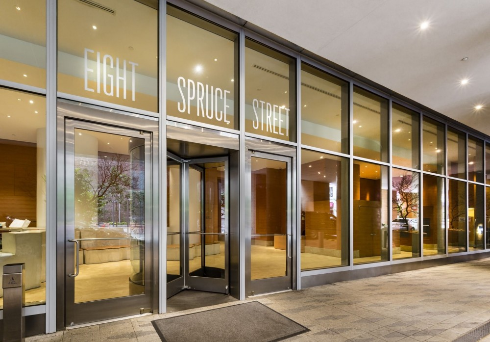 Stainless steel stile and rail-type balanced doors were used on New York by Gehry in New York City to provide a transparent aesthetic for the glass-enclosed lobby. [CREDIT] Photo © Barry Schwartz Photography