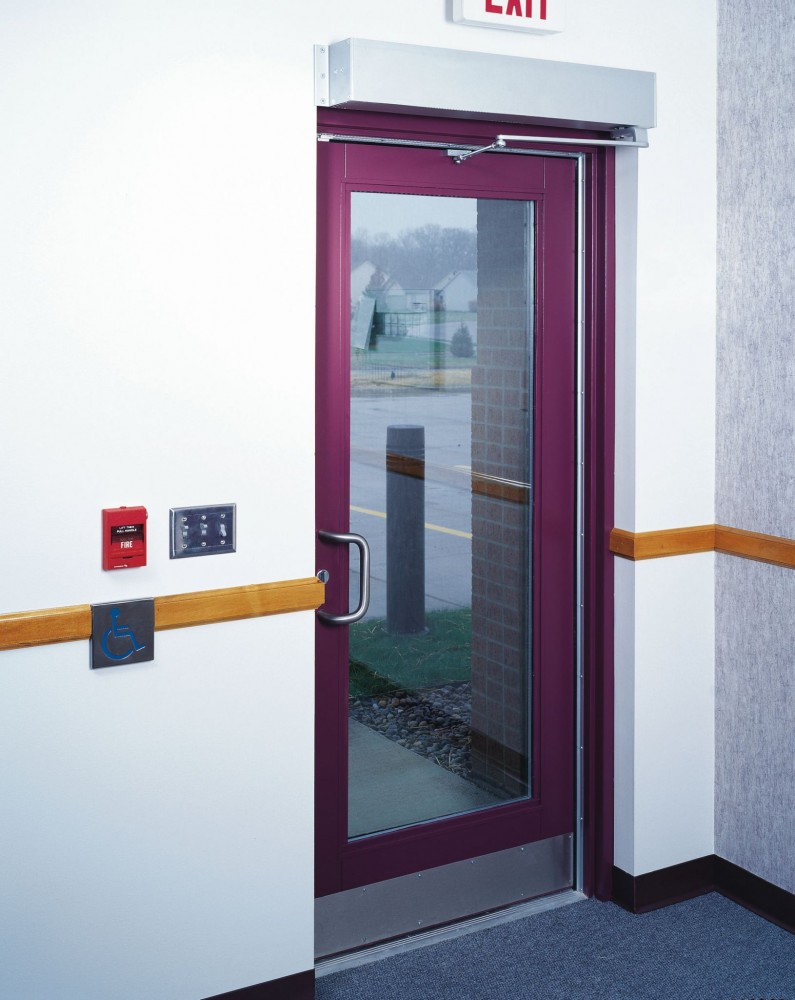 A low-energy automatic operator must be actuated by a knowing act (e.g. this wall-mounted push button), or must comply with the requirements of a Builders Hardware Manufacturers Association (BHMA) standard.