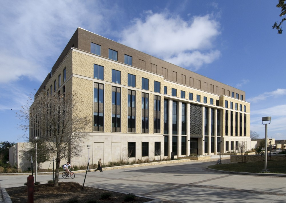 A fl uid-applied air and water barrier system is ideal for this building, which consists of multiple substrates and exterior claddings. The air barrier was installed over CMUs and gypsum board sheathing substrates; the multi-story curtain wall consisted of cut limestone on the fi rst fl oor, brick veneer on the upper fl oors, cast stone trim work, and perforated metal panels.