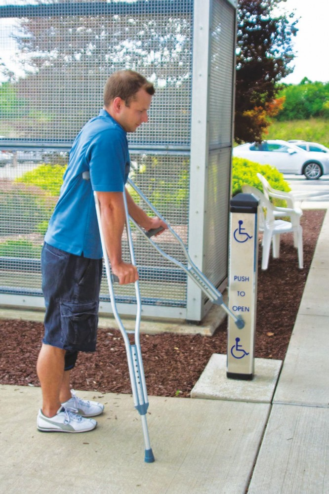 Some jurisdictions require actuators mounted in two positions, or a vertical bar actuator that will allow the door to be operated by a hand/arm or a crutch, cane, or wheelchair footrest.