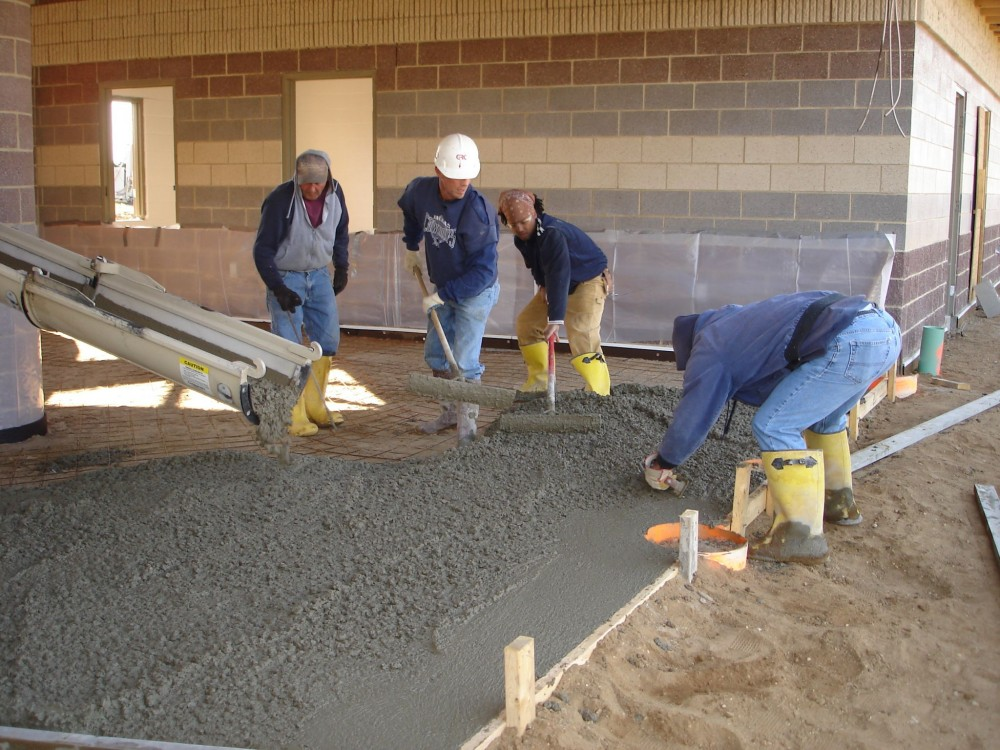 Low water-to-cement concrete is harder to move around and requires considerably more handwork to get it in place. Placement and spreading of low water-to-cement ratio concrete can be improved by adding water-reducing admixtures (WRAs)—however, excessive use can cause more drying shrinkage. These are rarely required by the specification, but are included in the specification as an alternate product that may be used.