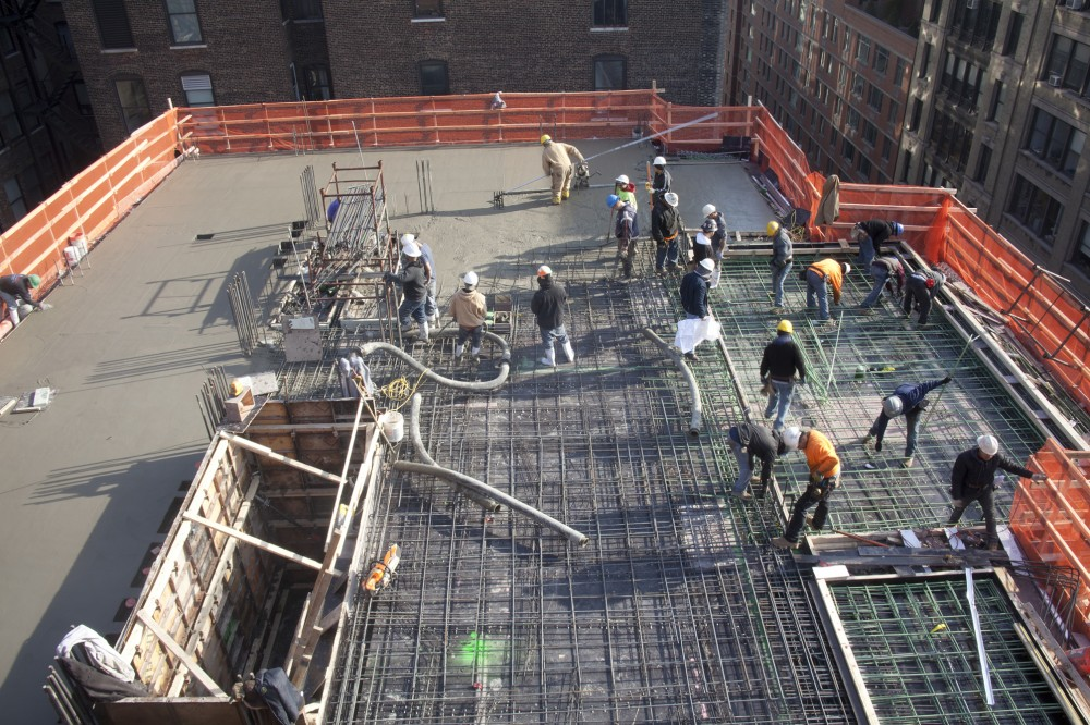 A birds-eye view of concrete pour after balcony thermal break connections are installed at Chelsea Green.