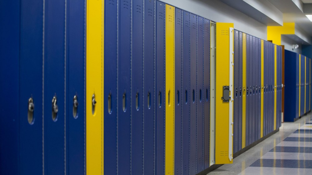 The high-density polyethylene (HDPE) lockers in Cologne Academy (Cologne, Minnesota) are fire-rated for corridors, selected in the school colors of yellow and blue. Photos courtesy Scranton Products