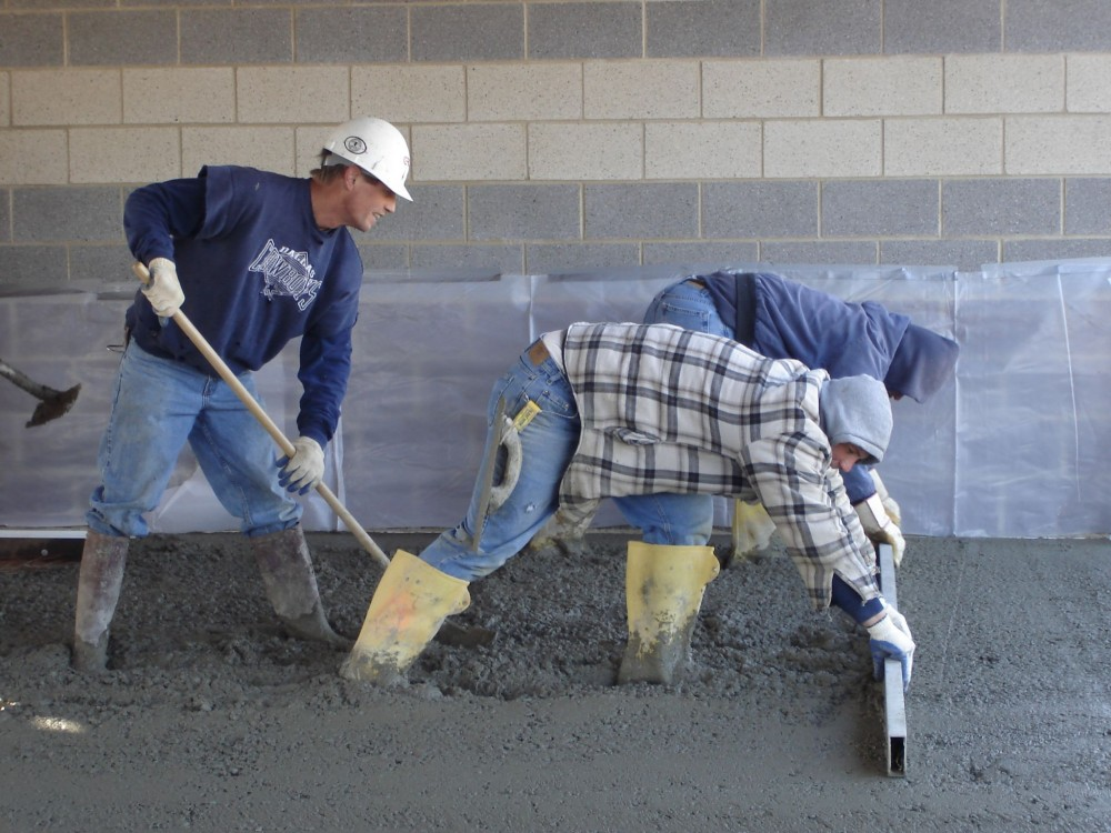 While finishing is not any more difficult with low w/c concrete, placement, and screeding require an ambitious crew.