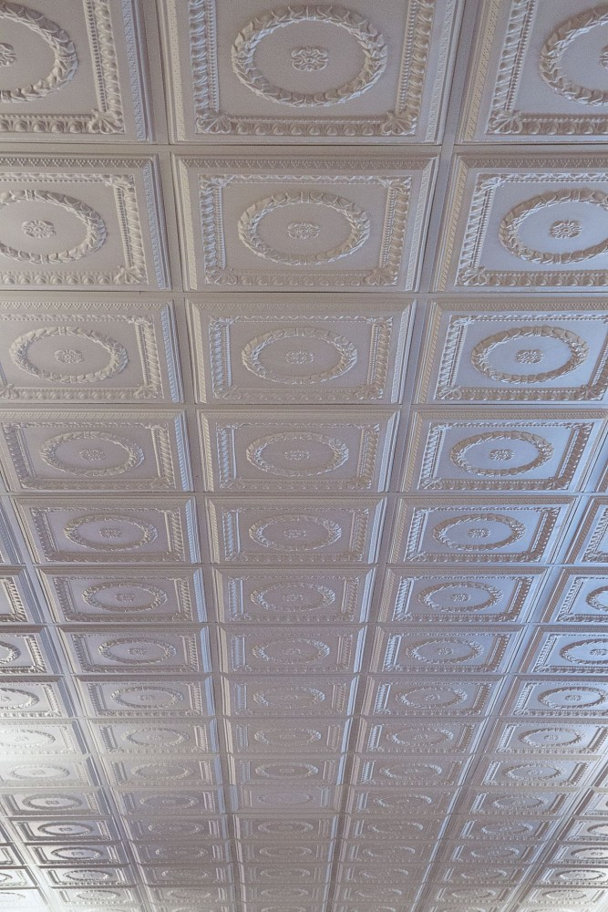 One glance at a thermoformed ceiling speaks immediately to the decorative potential of the molded panels and tiles. What is not seen, however, can be even more important—these panels can be installed beneath fire sprinklers to keep the ceiling surface uncluttered.
