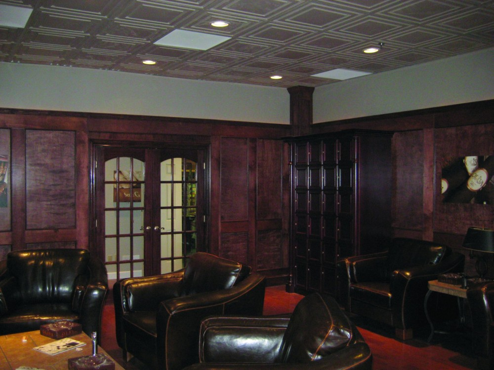 Thermoformed ceiling panels complement the panelized wood walls and doors to enhance the decorative motif of this cigar lounge. The ceiling panels do not absorb odors from cigar smoke and can be washed to remove tobacco stains.