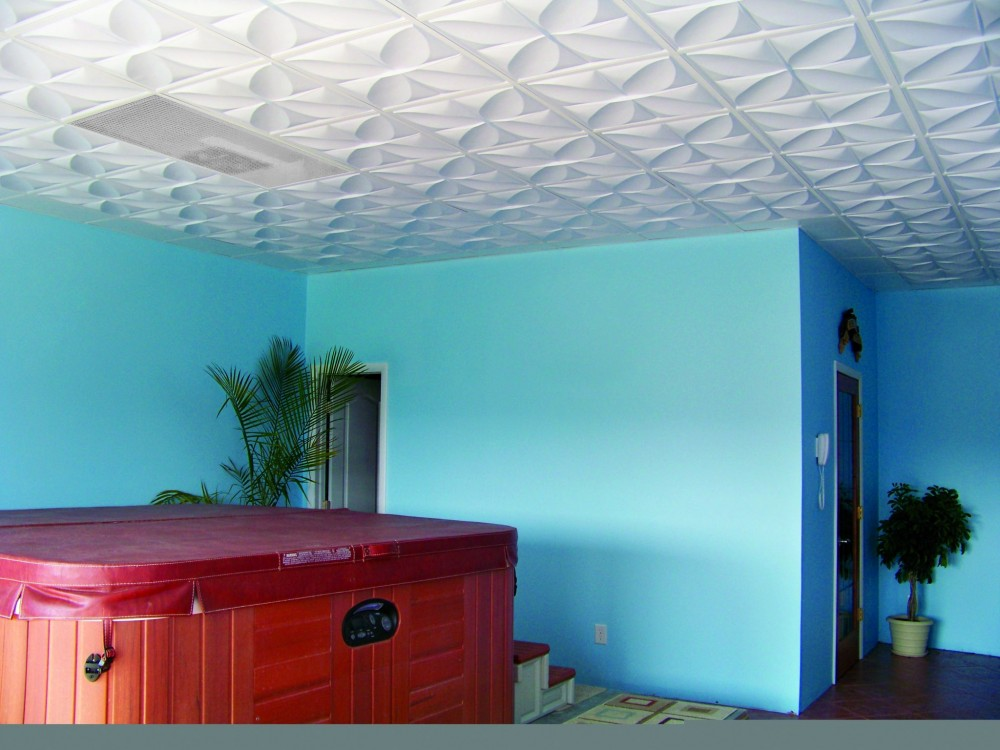 Thermoformed ceiling tiles and panels can be used in humid areas such as above the hot tub. The decorative molded pattern suggests ripples in water. During day, side light entering from glazed wall enhances relief with shadows and highlights; at night, the ceiling is back-lit. Border tile with low relief are used around perimeter of space.