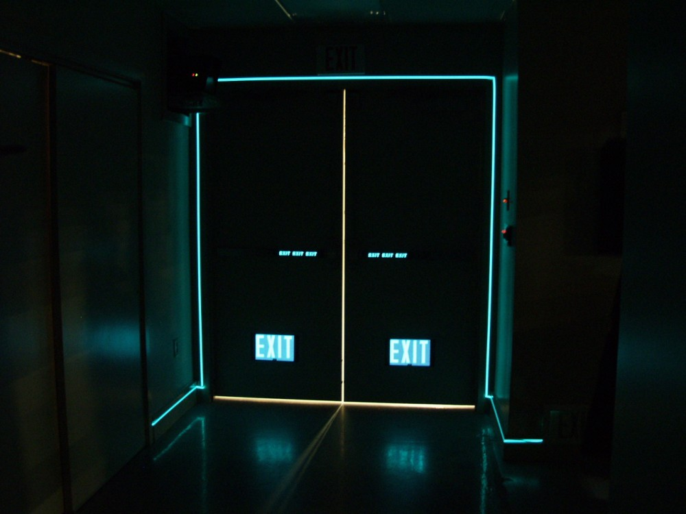 Electro-luminescence (EL) indicates an electric-powered, uninterrupted light source that increases visibility to locate exit doors. Photo courtesy Egress Marking Systems